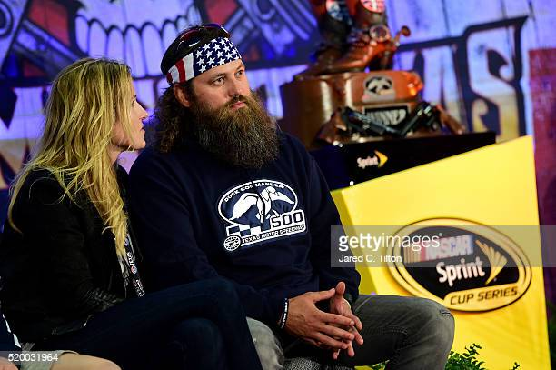 Willie and Korie Robertson are seen at the Driver's Meeting prior to the NASCAR Sprint Cup Series Duck Commander 500 at Texas Motor Speedway on April...