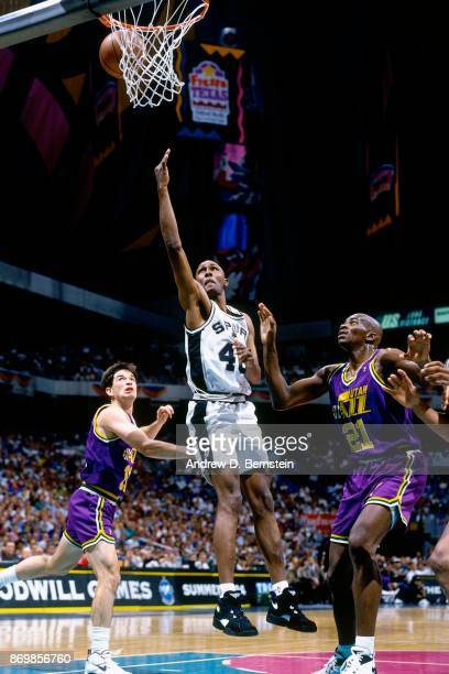 Willie Anderson of the San Antonio Spurs shoots against David Benoit of the Utah Jazz during Game Two of the 1994 Western Conference Quarterfinals...