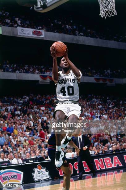 Willie Anderson of the San Antonio Spurs shoots during Game Two of the First Round of the 1995 NBA Playoffs played on April 30 1995 at the Alamo Dome...
