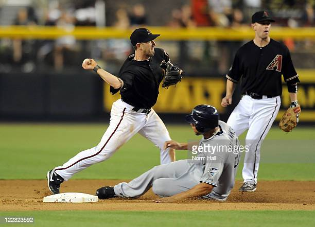 Willie Bloomquist of the Arizona Diamondbacks attempts to turn a double play as Kyle Blanks of the San Diego Padres slides into second base at Chase...
