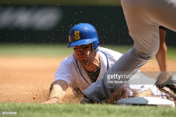 Willie Bloomquist of the Seattle Mariners dives head first into third against the Cleveland Indians on July 19, 2008 at Safeco Field in Seattle,...