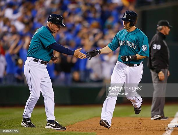Willie Bloomquist of the Seattle Mariners is congratulated by third base coach Rich Donnelly after hitting a tworun home run against the Houston...