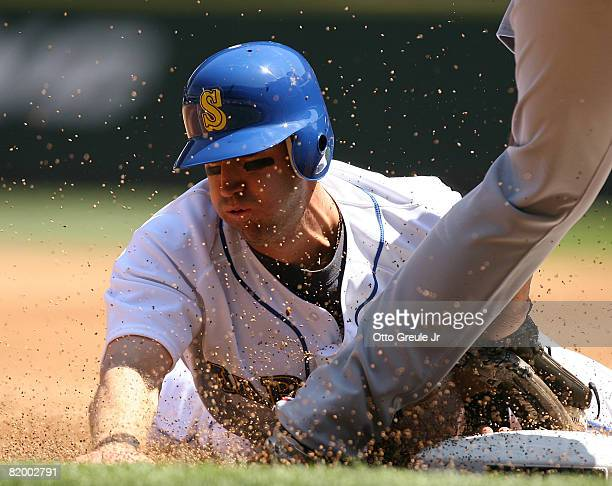 Willie Bloomquist of the Seattle Mariners steals third base against Andy Marte of the Cleveland Indians on July 19 2008 at Safeco Field in Seattle...