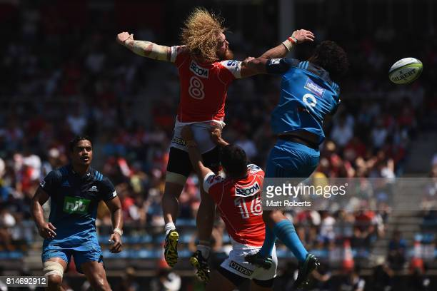 Willie Britz of the Sunwolves competes for the ball against Steven Luatua of the Blues during the Super Rugby match between the Sunwolves and the...