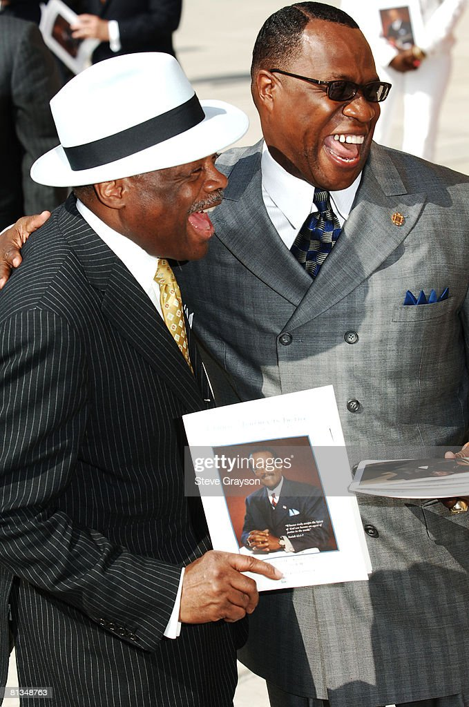 Willie Brown and Tony Muhammed arrive at the memorial service for Johnnie Cochran at West Angeles Cathederal in Los Angeles, California April 6, 2005