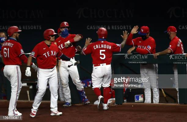 Willie Calhoun of the Texas Rangers celebrates a run against the Los Angeles Angels in the second inning at Globe Life Field on August 07 2020 in...