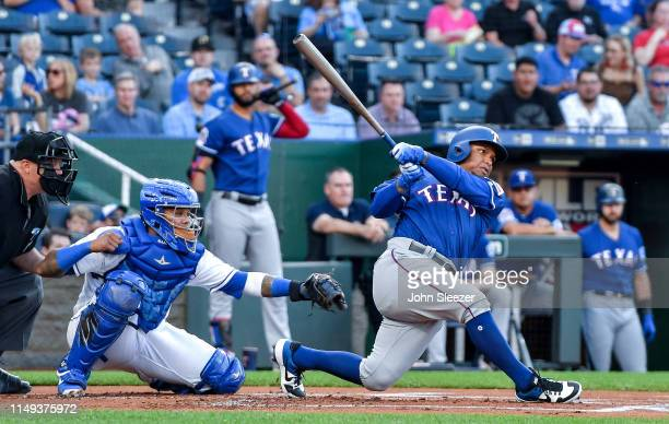 Willie Calhoun of the Texas Rangers connects on a two run home run in the first inning during the game against the Kansas City Royals at Kauffman...
