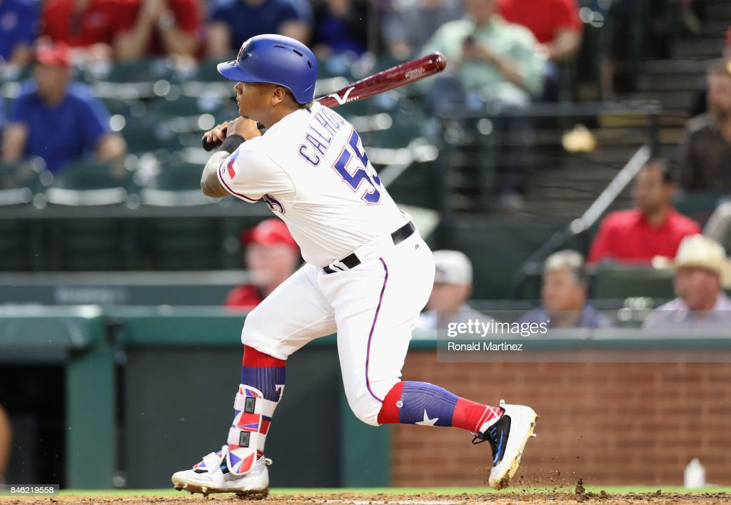 Willie Calhoun #55 of the Texas Rangers gets his first MLB rbi in the second inning against the Seattle Mariners at Globe Life Park in Arlington on September 12, 2017 in Arlington, Texas.