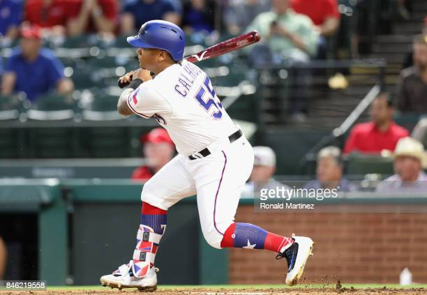 Willie Calhoun of the Texas Rangers gets his first MLB rbi in the second inning against the Seattle Mariners at Globe Life Park in Arlington on...