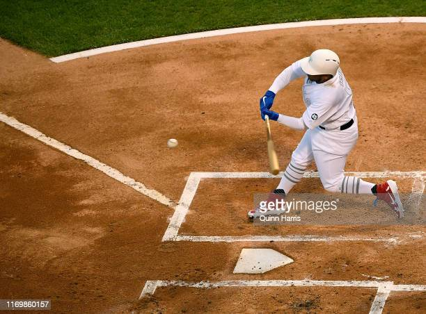 Willie Calhoun of the Texas Rangers hits a three run home run in the first inning against the Chicago White Sox at Guaranteed Rate Field on August 23...
