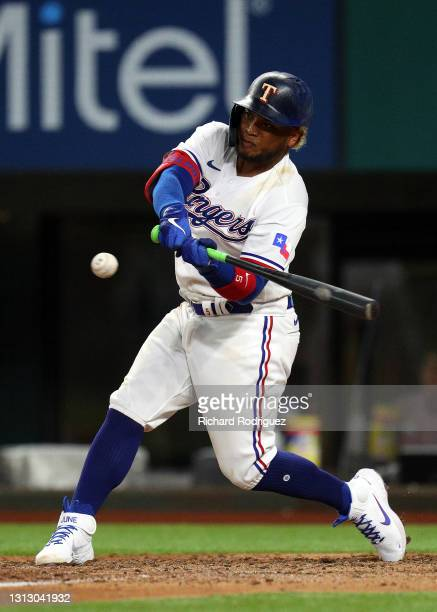 Willie Calhoun of the Texas Rangers hits into a fielder's choice in the seventh inning of the MLB game against the Baltimore Orioles at Globe Life...