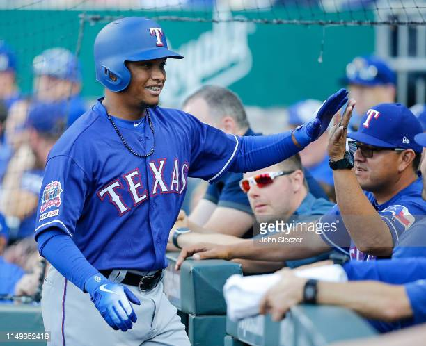 Willie Calhoun of the Texas Rangers is congratulated after hitting a two run home run in the first inning during the game against the Kansas City...
