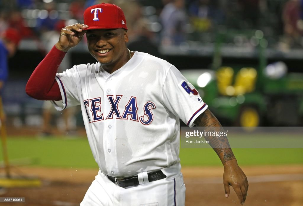Willie Calhoun #55 of the Texas Rangers reacts after being doused with Powerade by teammates following the Rangers win over the Oakland Athletics at Globe Life Park in Arlington on September 29, 2017 in Arlington, Texas. The Rangers won 5-3.