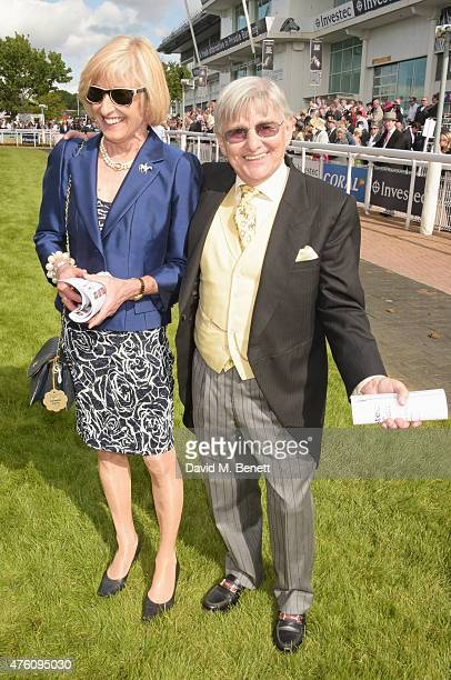 Willie Carson and wife Elaine attend Derby Day during the Investec Derby Festival at Epsom Racecourse on June 6 2015 in Epsom England