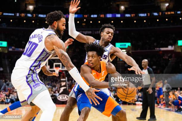 Willie CauleyStein and Buddy Hield of the Sacramento Kings double team Collin Sexton of the Cleveland Cavaliers during the second half at Quicken...