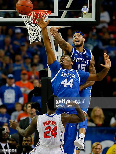Willie Cauley-Stein and Dakari Johnson of the Kentucky Wildcats block a shot by Casey Prather of the Florida Gators in the second half during the...