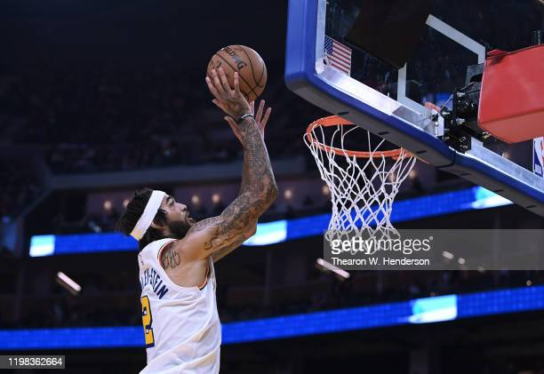 Willie CauleyStein of the Golden State Warriors shoots and scores against the Milwaukee Bucks during the second half of an NBA basketball game at...