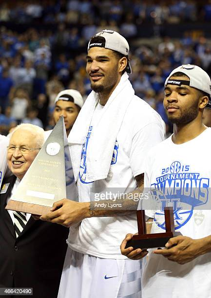 Willie Cauley-Stein of the Kentucky Wildcats celebrates on the court with his teammates after defeating the Arkansas Razorbacks 78-63 in the...