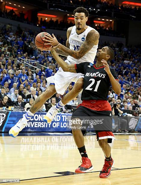 Willie Cauley-Stein of the Kentucky Wildcats drives past Farad Cobb of the Cincinnati Bearcats during the third round of the 2015 NCAA Men's...
