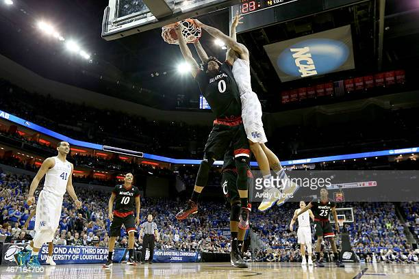 Willie Cauley-Stein of the Kentucky Wildcats dunks on Quadri Moore of the Cincinnati Bearcats during the third round of the 2015 NCAA Men's...