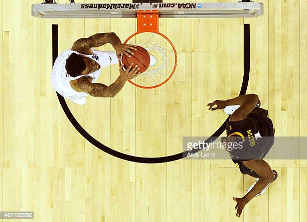 Willie Cauley-Stein of the Kentucky Wildcats goes up for a dunk in the first half against Jonathan Holton of the West Virginia Mountaineers during...