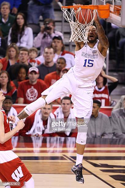 Willie CauleyStein of the Kentucky Wildcats goes up for a dunk against Sam Dekker of the Wisconsin Badgers in the first half during the NCAA Men's...