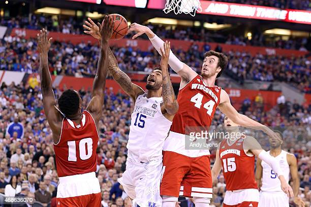 Willie Cauley-Stein of the Kentucky Wildcats goes up with the ball against Nigel Hayes and Frank Kaminsky of the Wisconsin Badgers in the second half...