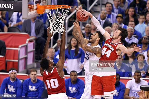 Willie CauleyStein of the Kentucky Wildcats goes up with the ball against Nigel Hayes and Frank Kaminsky of the Wisconsin Badgers in the second half...