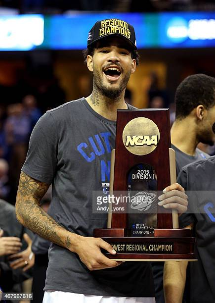 Willie Cauley-Stein of the Kentucky Wildcats holds his team's trophy after defeating the Notre Dame Fighting Irish during the Midwest Regional Final...