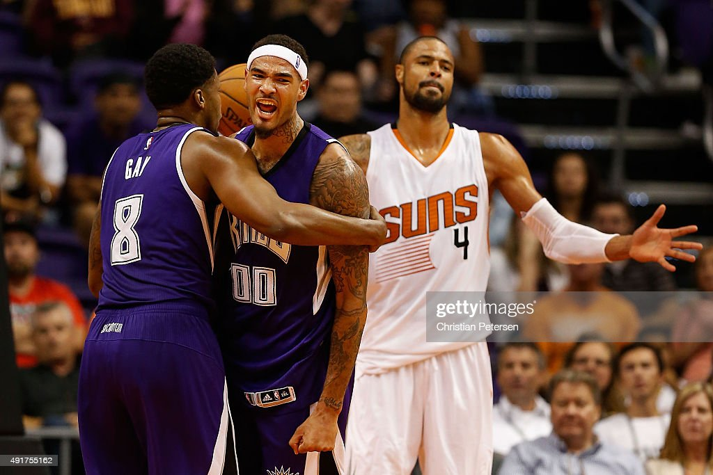 Willie Cauley-Stein #00 of the Sacramento Kings celebrates with Rudy Gay #8 after scoring against Tyson Chandler #4 of the Phoenix Suns during the second half of the preseason NBA game at Talking Stick Resort Arena on October 7, 2015 in Phoenix, Arizona.