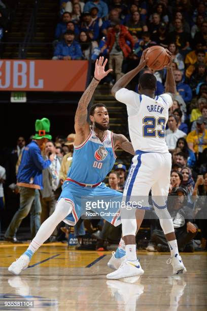 Willie CauleyStein of the Sacramento Kings defends against Draymond Green of the Golden State Warriors during the game between the two teams on March...