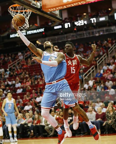 Willie CauleyStein of the Sacramento Kings drives around Clint Capela of the Houston Rockets for a reverse layup at Toyota Center on February 14 2018...