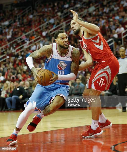 Willie CauleyStein of the Sacramento Kings drives around Ryan Anderson of the Houston Rockets at Toyota Center on February 14 2018 in Houston Texas...