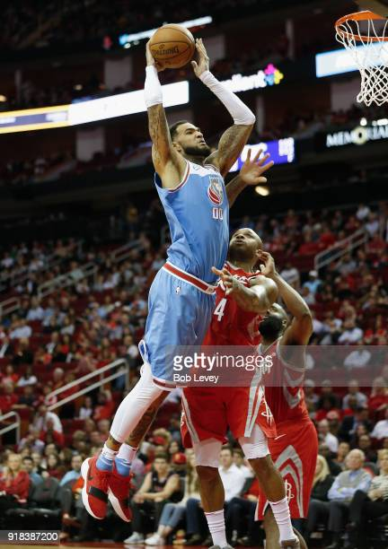 Willie CauleyStein of the Sacramento Kings drives past PJ Tucker of the Houston Rockets for a dunk in the fourth quarter at Toyota Center on February...