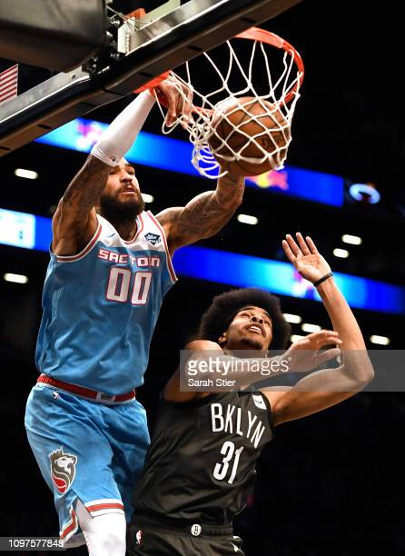 Willie CauleyStein of the Sacramento Kings dunks against Jarrett Allen of the Brooklyn Nets during the second quarter of the game at Barclays Center...