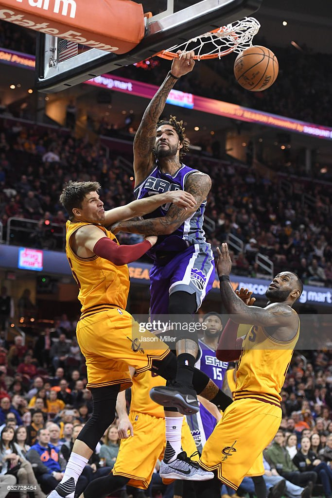 Willie Cauley-Stein #00 of the Sacramento Kings dunks over Kyle Korver #26 and LeBron James #23 of the Cleveland Cavaliers during the second half at Quicken Loans Arena on January 25, 2017 in Cleveland, Ohio. The Kings defeated the Cavaliers 116-112 in overtime.