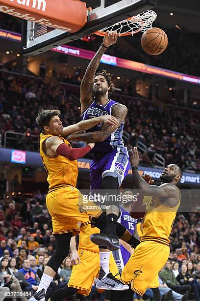 Willie CauleyStein of the Sacramento Kings dunks over Kyle Korver and LeBron James of the Cleveland Cavaliers during the second half at Quicken Loans...