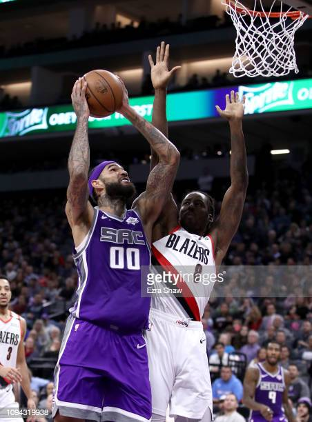 Willie CauleyStein of the Sacramento Kings goes up for a shot against AlFarouq Aminu of the Portland Trail Blazers at Golden 1 Center on January 14...