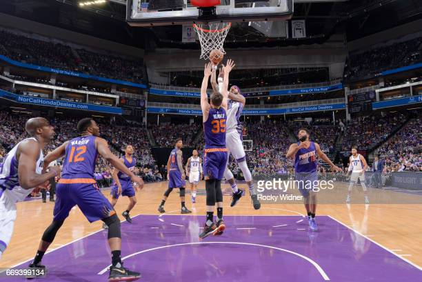 Willie CauleyStein of the Sacramento Kings shoots against Dragan Bender of the Phoenix Suns on April 11 2017 at Golden 1 Center in Sacramento...