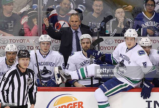 Willie Desjardins head coach of the Vancouver Canucks gestures from the bench in third period action in an NHL game against the Winnipeg Jets at the...