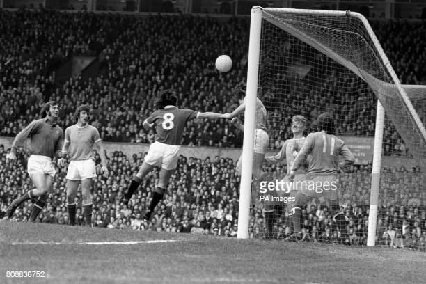 Willie Donachie heads clear from the Manchester City goal line as relegationthreatened Manchester United put on pressure