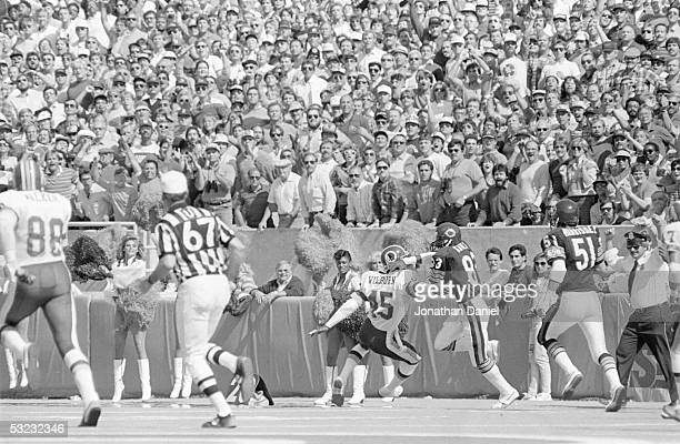 Willie Gault of the Chicago Bears heads upfield pursued by Barry Wilburn of the Washington Redskins during the game at Soldier Field on September 29...