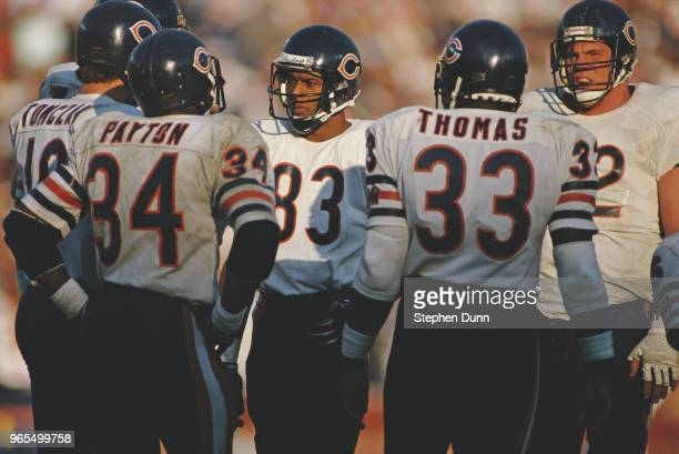 Willie Gault, Wide Receiver for the Chicago Bears in the huddle with Mike Tomczak, Walter Payton and Calvin Thomas during the American Football...