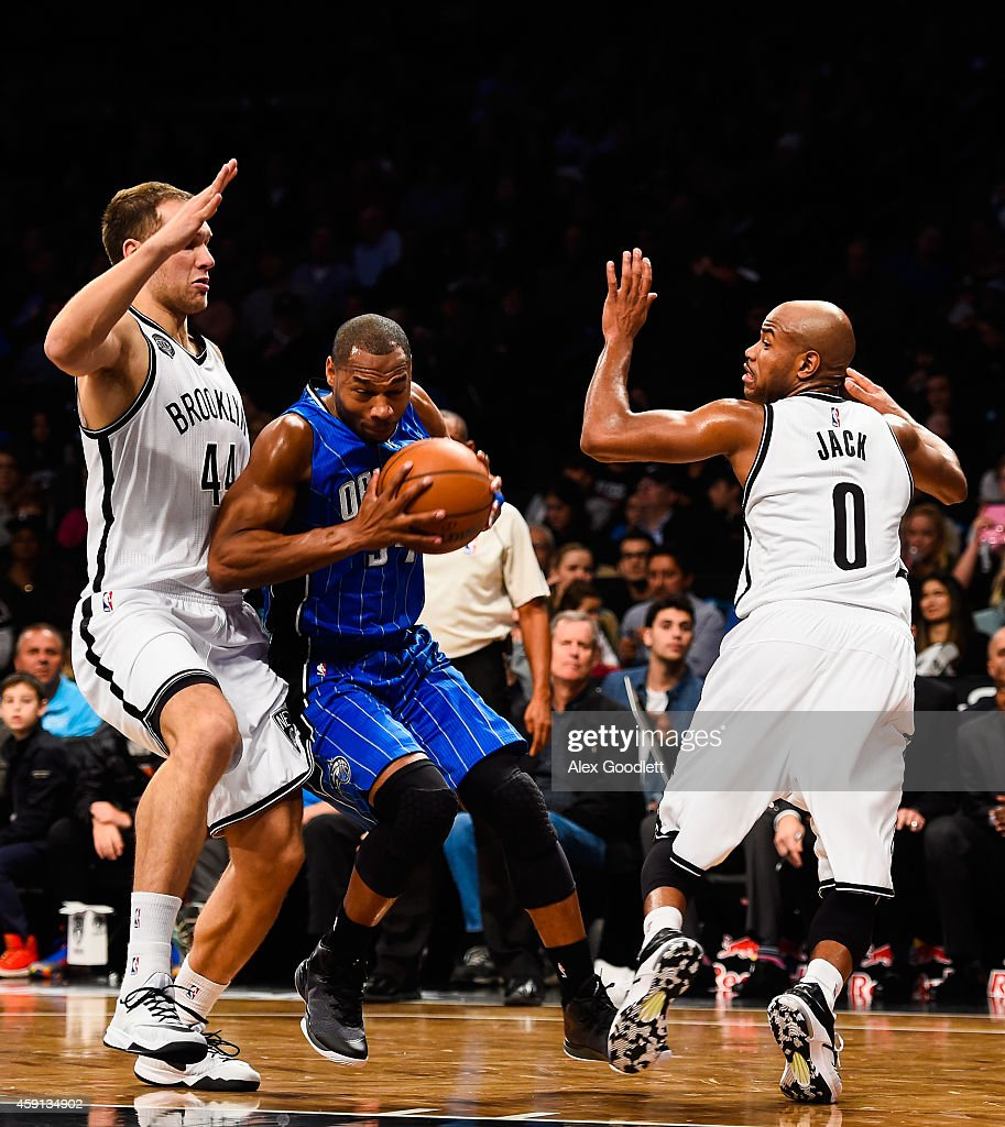 Willie Green #34 of the Orlando Magic attempts to dribble between Bojan Bogdanovic #44 and Jarrett Jack #0 of the Brooklyn Nets in the first half at the Barclays Center on November 9, 2014 in the Brooklyn borough of New York City.