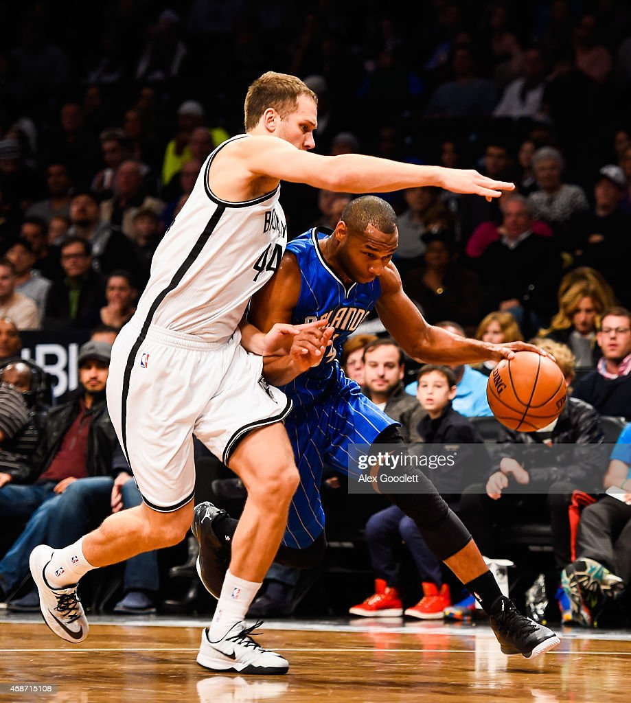 Willie Green #34 of the Orlando Magic dribbles under Bojan Bogdanovic #44 of the Brooklyn Nets in the first half at the Barclays Center on November 9, 2014 in the Brooklyn borough of New York City.