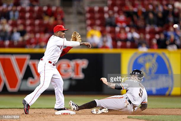 Willie Harris of the Cincinnati Reds turns a double play against Brandon Belt of the San Francisco Giants to end the game at Great American Ball Park...