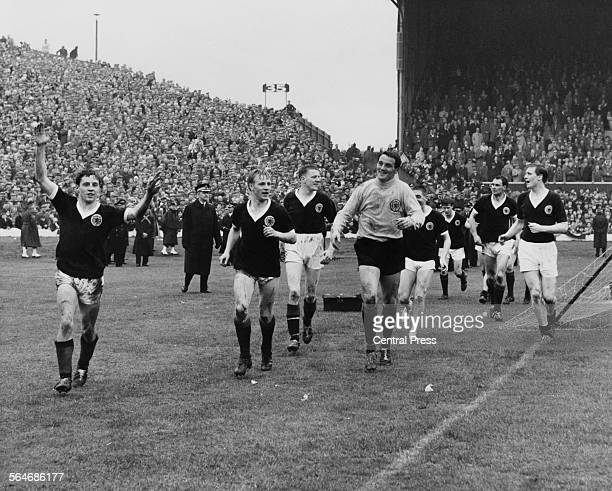 Willie Henderson leads the Scottish team on a lap of honour at Hampden Park Glasgow after their 10 victory over England to win the British...