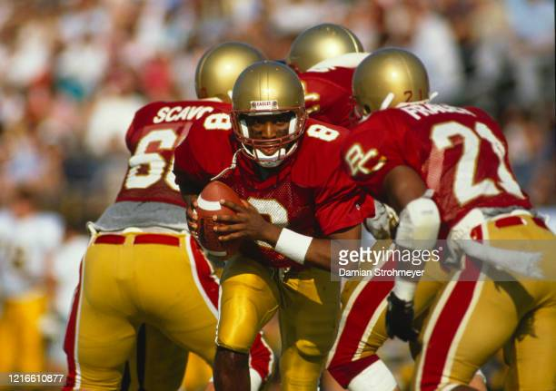 Willie Hicks, Quarterback for the Boston College Eagles prepares to hand the ball off to Running back Tim Frager during the NCAA Independent...