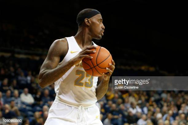Willie Jackson of the Toledo Rockets looks to pass the ball in the game against the Ball State Cardinals during the second half at Savage Arena on...