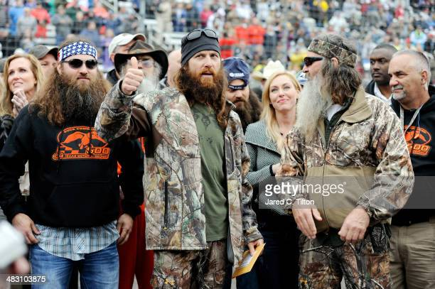 Willie Jase Jessica and Phil Robertson take part in prerace ceremonies for the NASCAR Sprint Cup Series Duck Commander 500 at Texas Motor Speedway on...